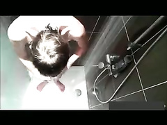 Voyeur watches a twink masturbate in shower