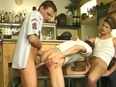 Uniformed studs having a group fuck in the bar