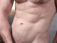 Tattooed young twink excitingly wanks his cock on couch