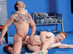Beauty gay with color tattoo is pleasuring bareback fuck in GYM
