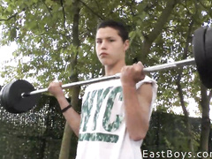 Cute teen gay is lifting weight before fondling his dick