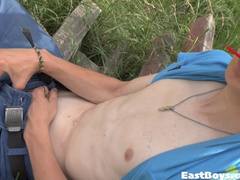Kinky gay is playing with himself outdoor