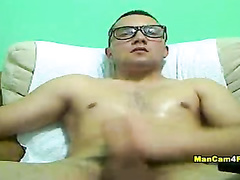 Four eyed dude loves massaging his dick head
