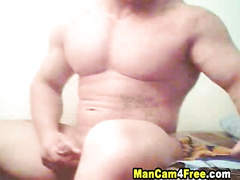 Muscular male gives pleasure to his cock